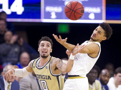 Notre Dame's Prentiss Hubb, right, recovers the ball during a steal attempt by Georgia Tech's Jose Alvarado (10) during the first half of an NCAA college basketball game Sunday, Feb. 10, 2019, in South Bend, Ind.