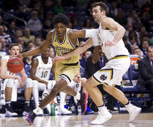 Georgia Tech's Khalid Moore, left, drives by Notre Dame's John Mooney during the first half of an NCAA college basketball game Sunday, Feb. 10, 2019, in South Bend, Ind.