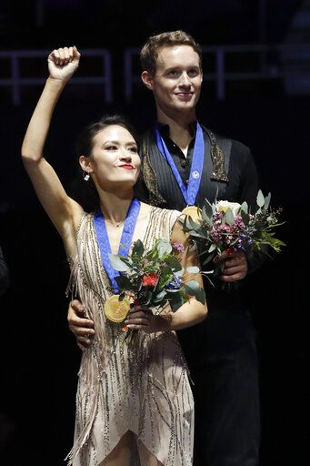 Ice dance competition winners, gold medalists, Madison Chock and Evan Bates, of the United States, pose at the Four Continents Figure Skating Championships on Sunday, Feb. 10, 2019, in Anaheim, Calif.