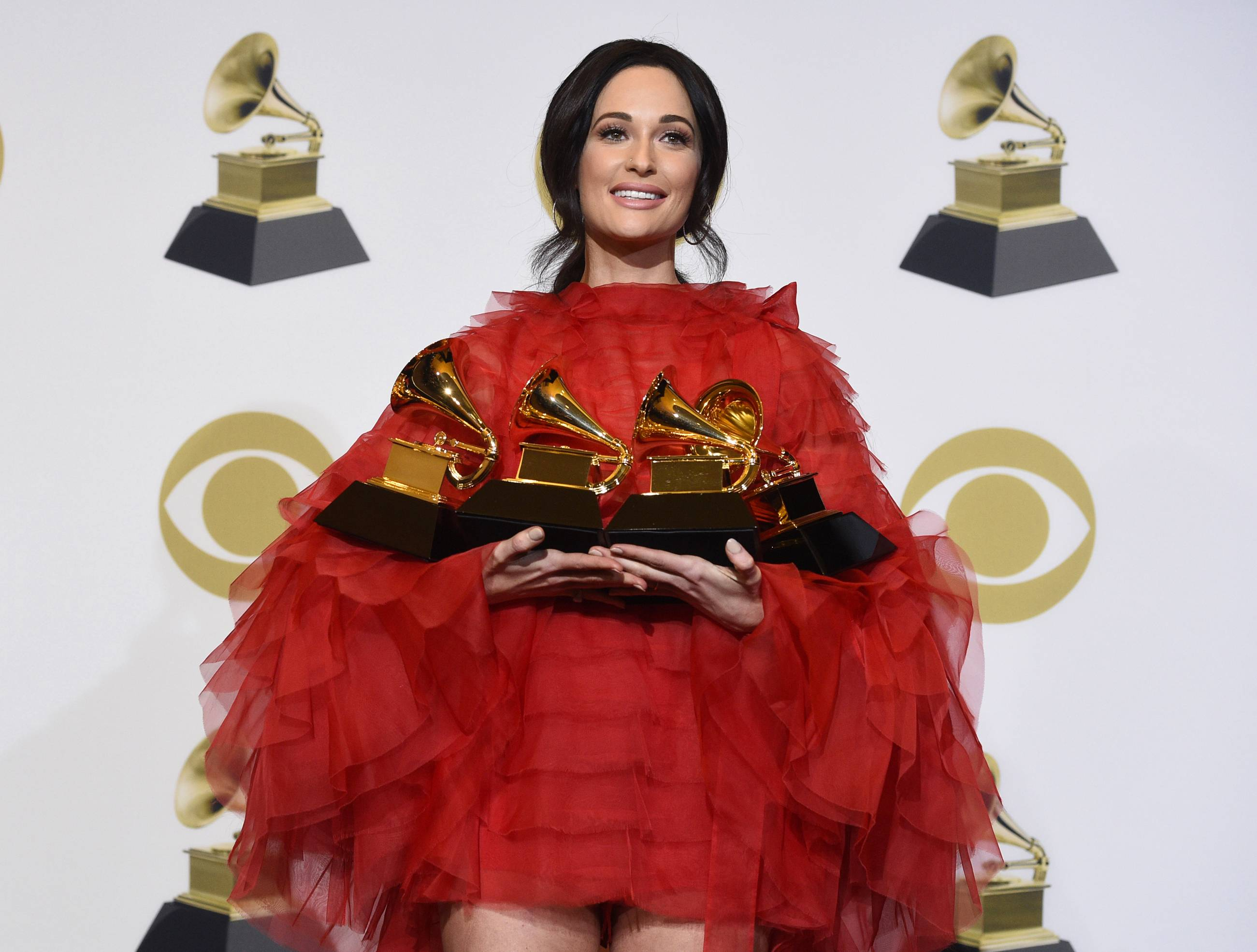 "Kacey Musgraves, winner of the awards for best country album for ""Golden Hour,"" best country song for ""Space Cowboy,"" best country solo performance for ""Butterflies"" and album of the year for ""Golden Hour"" poses Sunday in the press room at the 61st annual Grammy Awards at the Staples Center in Los Angeles."