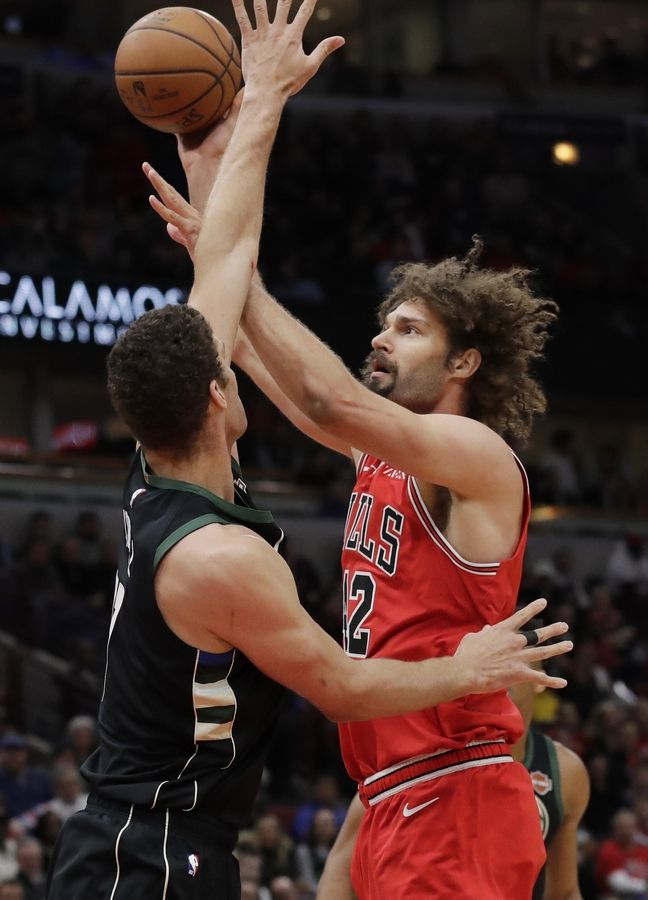 Chicago Bulls center Robin Lopez, right, shoots against Milwaukee Bucks center Brook Lopez during the first half of an NBA basketball game Monday, Feb. 11, 2019, in Chicago.