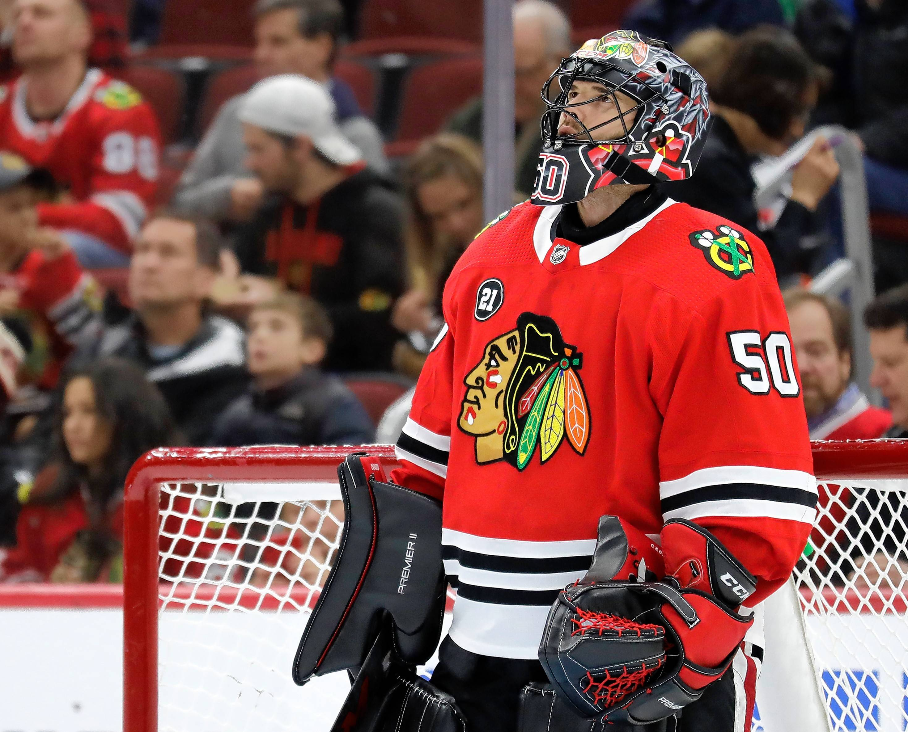 "Corey Crawford said things are looking up after he participated in a full practice Monday since suffering a concussion Dec. 16. ""Back to normal,"" he said."