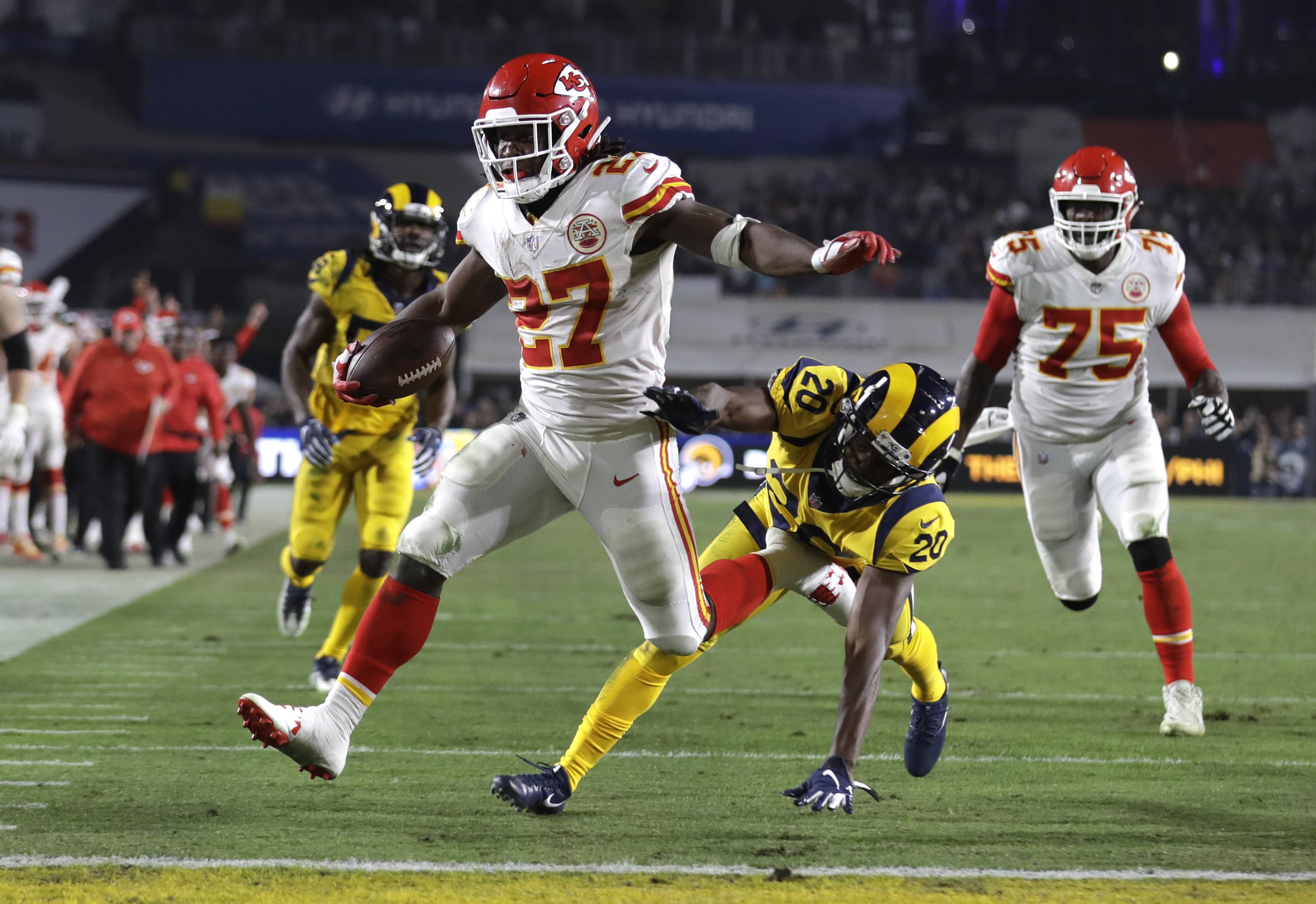 "Kansas City Chiefs running back Kareem Hunt scores a touchdown against the Los Angeles Rams. The Cleveland Browns have signed Hunt, the running back cut by Kansas City in November after a video showed him pushing and kicking a woman the previous February. Cleveland general manager John Dorsey, who drafted Hunt while working for Kansas City, on Monday, Feb. 11, 2019,  said the Browns ""fully understand and respect the complexity of questions and issues in signing a player with Kareem's history and do not condone his actions."""