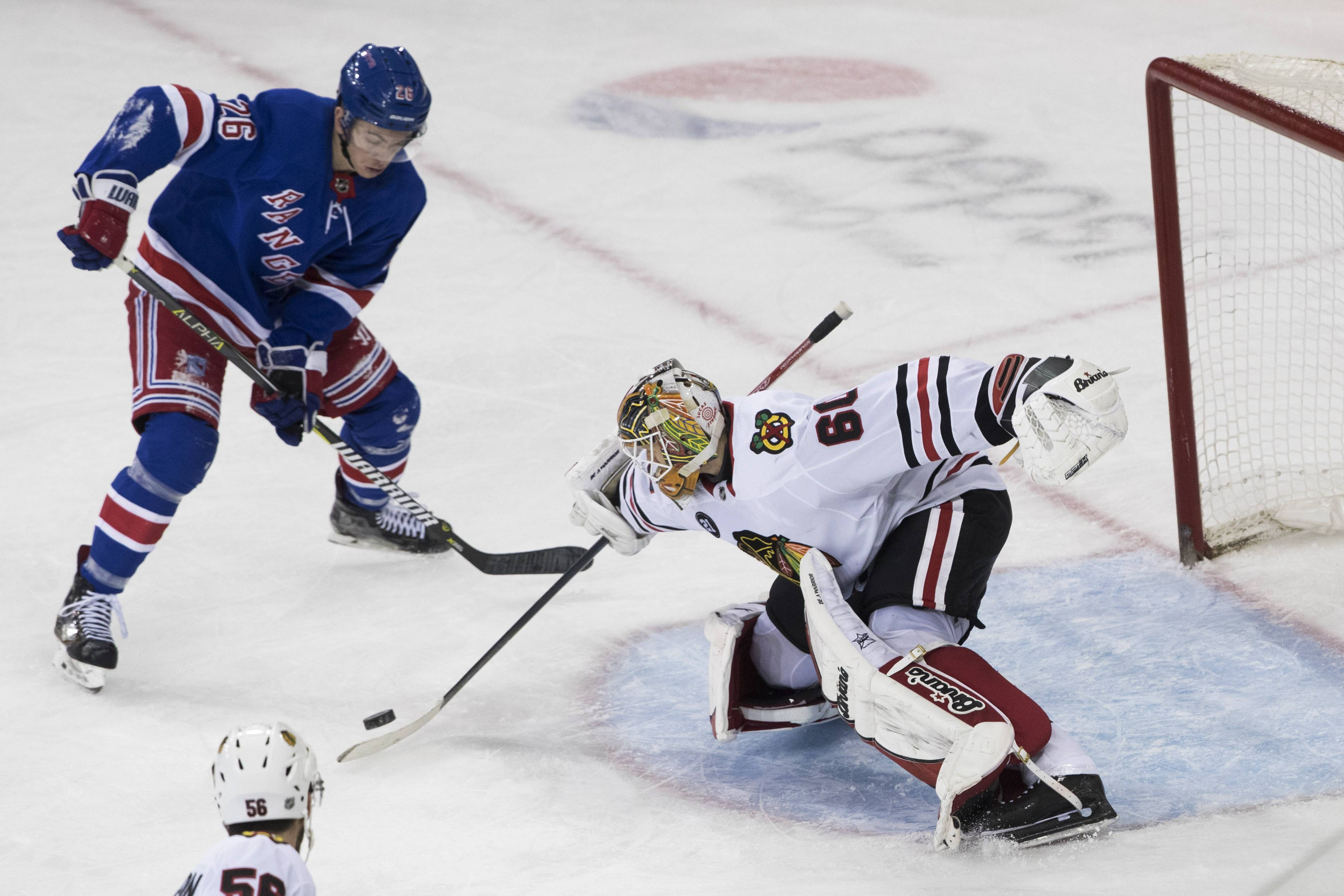 Blackhawks goaltender Collin Delia signed a three-year contract extension Monday.