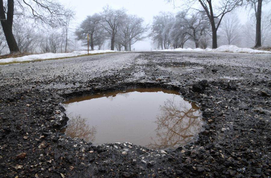 Some potholes, including this one in the Lakewood Forest Preserve near Wauconda, can be harder to see because they are filled with water.