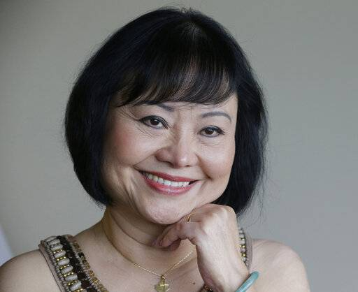 In this Sept. 25, 2015 photo, Kim Phuc poses for a photo at a hotel in Miami.
