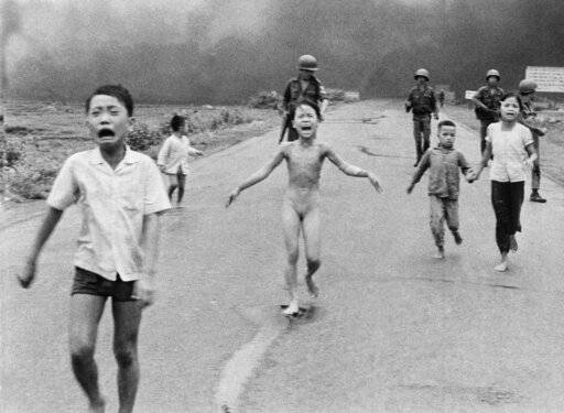 FILE - In this June 8, 1972 file photo, South Vietnamese forces follow after terrified children, including 9-year-old Kim Phuc, center, as they run down Route 1 near Trang Bang after an aerial napalm attack on suspected Viet Cong hiding places. A South Vietnamese plane accidentally dropped its flaming napalm on South Vietnamese troops and civilians. The terrified girl had ripped off her burning clothes while fleeing. The children from left to right are: Phan Thanh Tam, younger brother of Kim Phuc, who lost an eye, Phan Thanh Phouc, youngest brother of Kim Phuc, Kim Phuc, and Kim's cousins Ho Van Bon, and Ho Thi Ting. Behind them are soldiers of the Vietnam Army 25th Division.
