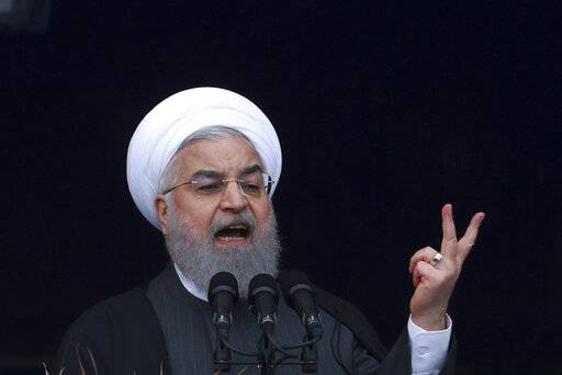 "Iranian President Hassan Rouhani speaks during a ceremony celebrating the 40th anniversary of the Islamic Revolution, at the Azadi, Freedom, Square in Tehran, Iran, Monday, Feb. 11, 2019. Speaking from a podium in central Tehran, Rouhani addressed the crowds for nearly 45 minutes, lashing out at Iran's enemies - America and Israel - and claiming that their efforts to ""bring down"" Iranians through sanctions will not succeed."