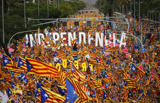 FILE - In this Tuesday, Sept. 11, 2018 file photo, pro-Independence demonstrators gather at La Diagonal, one Barcelona's main avenues, during the Catalan National Day in Barcelona, Spain. Spain's Supreme Court is bracing to hold the nation's most sensitive trial in four decades of democracy this week with all eyes focused on its ability to stand up to concerted campaign by Catalonia's separatists to attack its credibility.