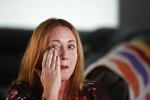 Lori Alhadeff, mother of 14-year-old Alyssa Alhadeff who was one of 17 people killed at Marjory Stoneman Douglas High School, wipes away a tear as she cries while talking about her daughter on Wednesday, Jan. 30, 2019, in Parkland, Fla. She and her husband marched with Parkland students in Washington, demanding gun control. And in May, she was elected to the school board.
