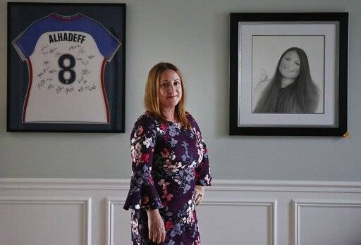 "Lori Alhadeff, mother of 14-year-old Alyssa Alhadeff who was one of 17 people killed at Marjory Stoneman Douglas High School, stands for a portrait in her home, on Wednesday, Jan. 30, 2019, in Parkland, Fla. The day of the shooting, she approached a line of reporters. She did not know what to say. But she felt compelled to speak. ""A crazy person just walks right into the school, knocked on the window of my child's door and starts shooting, shooting her and killing her,� she screamed. ""President Trump, you say what can you do, you can stop the guns from getting into these children's hands, put metal detectors at every entrance to the school.�"