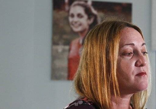 Lori Alhadeff, mother of 14-year-old Alyssa Alhadeff who was one of 17 people killed at Marjory Stoneman Douglas High School, speaks during an interview with a portrait of her daughter in the background, on Wednesday, Jan. 30, 2019, in Parkland, Fla. A 44-year-old former teacher, Alhadeff started Make Our Schools Safe, aiming to harden schools against intruders and to train students and teachers so they know how to respond. Test scores don't matter, she says, if kids don't come home alive.