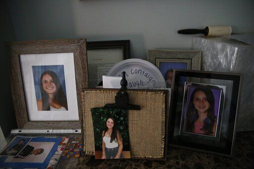 Photographs of 14-year-old Alyssa Alhadeff, one of 17 people killed by a gunman who stalked the halls of Marjory Stoneman Douglas High School, sit on a table in her home on Wednesday, Jan. 30, 2019, in Parkland, Fla.