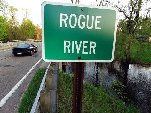 FILE - In this May 16, 2018 file photo the Rogue River flows underneath Algoma Ave. NE in Algoma Township, Mich. The Michigan DEQ is asking Wolverine World Wide to expand perfluoroalkyl and polyfluoroalkyl compounds, or PFAS, testing in the area. There's growing evidence that long-term exposure to the perfluoroalkyl and polyfluoroalkyl compounds, or PFAS, can be dangerous, even in tiny amounts.  The Environmental Protection Agency is looking at how to respond to a public push for stricter regulation of the chemicals, in production since the 1940s.  A decision is expected soon. (Garret Ellison/The Grand Rapids Press via AP)