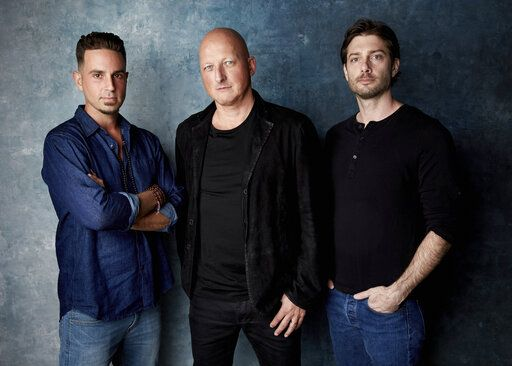 "FILE - In this Jan. 24, 2019, file photo, Wade Robson, from left, director Dan Reed and James Safechuck pose for a portrait to promote the film ""Leaving Neverland"" at the Salesforce Music Lodge during the Sundance Film Festival in Park City, Utah. The Michael Jackson estate has sent a letter to the U.K.'s Channel 4 warning that the documentary on Robson and Safechuck, who accuse the singer of molesting them as boys violates the network's programming guidelines. Estate attorneys say in the letter released to The Associated Press on Monday, Feb. 11, that ""Leaving Neverland,"" includes no response from Jackson defenders as the channel's guidelines require. (Photo by Taylor Jewell/Invision/AP, File)"