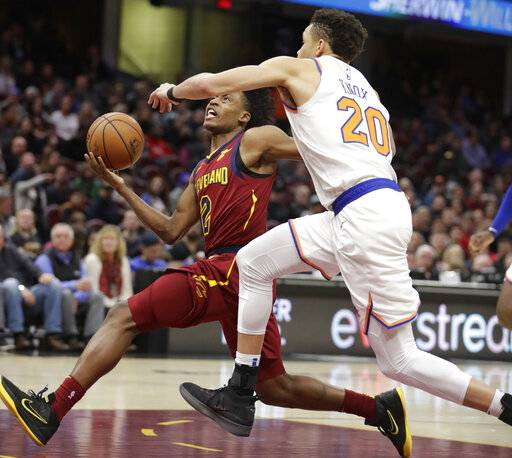 Cleveland Cavaliers' Collin Sexton (2) drives to the basket against New York Knicks' Kevin Knox (20) in the first half of an NBA basketball game, Monday, Feb. 11, 2019, in Cleveland.