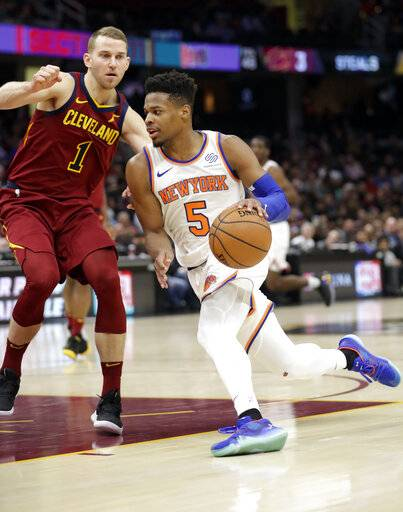 New York Knicks' Dennis Smith Jr. (5) drives past Cleveland Cavaliers' Nik Stauskas (1) in the second half of an NBA basketball game, Monday, Feb. 11, 2019, in Cleveland. The Cavaliers won 107-104.