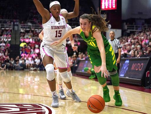 Oregon guard Sabrina Ionescu (20) moves the ball past Stanford forward Maya Dodson (15) during the second half of an NCAA college basketball game Sunday, Feb. 10, 2019, in Stanford, Calif. Oregon won 88-48.