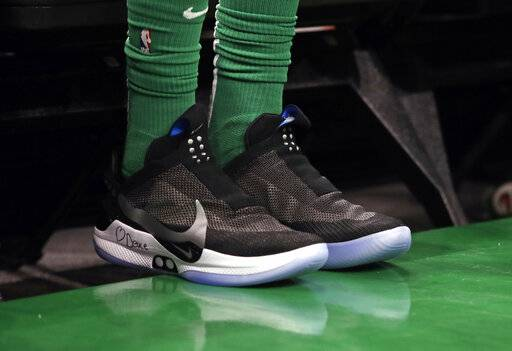 In this Feb. 7, 2019 photo, Boston Celtics forward Jayson Tatum sits on the bench during an NBA basketball game against the Los Angeles Lakers in Boston. He is wearing Nike's latest performance basketball shoes, which from concept to reality, took about three years to put together. Or 30 years, depending on how you count. The Nike Adapt BB _ a self-lacing smart shoe that can be controlled by a smartphone _ gets released to the public on Sunday, Feb. 17, 2019, a date that just happens to coincide with the NBA All-Star Game in Charlotte. It has a motor embedded within the shoe, and a hefty $350 price tag. It has a motor embedded within the shoe, and a hefty $350 price tag.
