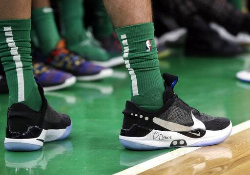 In this Feb. 7, 2019 photo, Boston Celtics forward Jayson Tatum stands at the bench area during an NBA basketball game against the Los Angeles Lakers in Boston. He is wearing Nike's latest performance basketball shoes, which from concept to reality, took about three years to put together. Or 30 years, depending on how you count. The Nike Adapt BB _ a self-lacing smart shoe that can be controlled by a smartphone _ gets released to the public on Sunday, Feb. 17, 2019, a date that just happens to coincide with the NBA All-Star Game in Charlotte. It has a motor embedded within the shoe, and a hefty $350 price tag. It has a motor embedded within the shoe, and a hefty $350 price tag.