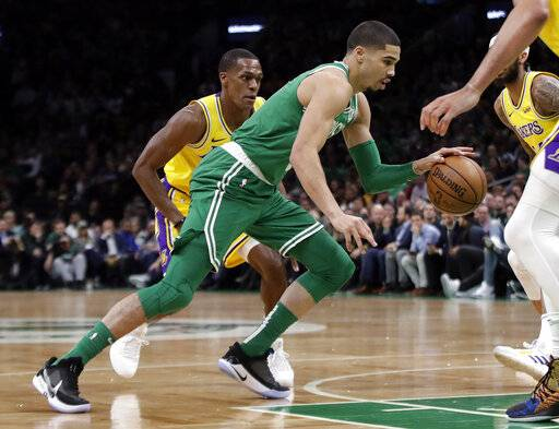 In this Feb. 7, 2019, photo, Boston Celtics forward Jayson Tatum drives against the Los Angeles Lakers during an NBA basketball game in Boston. He is wearing Nike's latest performance basketball shoes, which from concept to reality, took about three years to put together. Or 30 years, depending on how you count. The Nike Adapt BB _ a self-lacing smart shoe that can be controlled by a smartphone _ gets released to the public on Sunday, Feb. 17, 2019, a date that just happens to coincide with the NBA All-Star Game in Charlotte. It has a motor embedded within the shoe, and a hefty $350 price tag. It has a motor embedded within the shoe, and a hefty $350 price tag.