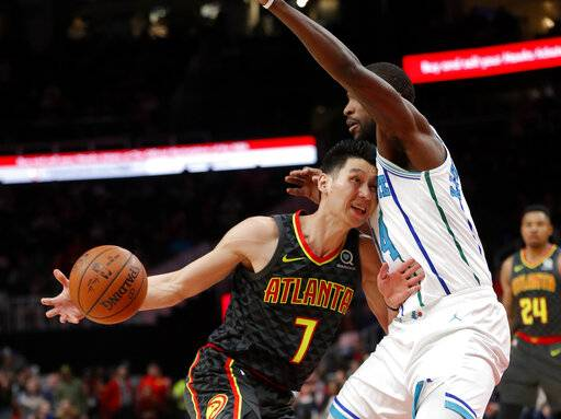 Atlanta Hawks guard Jeremy Lin (7) drives into Charlotte Hornets forward Michael Kidd-Gilchrist (14) during the first half of an NBA basketball Saturday, Feb. 9, 2019, in Atlanta.