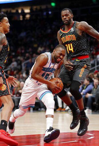 423f167200d7 Charlotte Hornets guard Kemba Walker (15) drives against Atlanta Hawks  center Dewayne Dedmon (