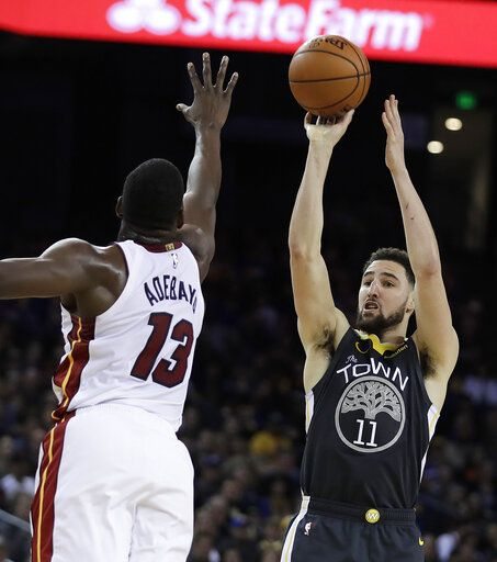 c901bb941b4 Cousins  late free throws lead Warriors past Heat 120-118