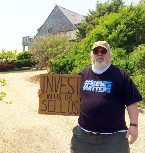 Evan Brandt, a reporter for the Pottstown Mercury in Pennsylvania, protests outside the vacation home of Heath Freeman in May 2018.