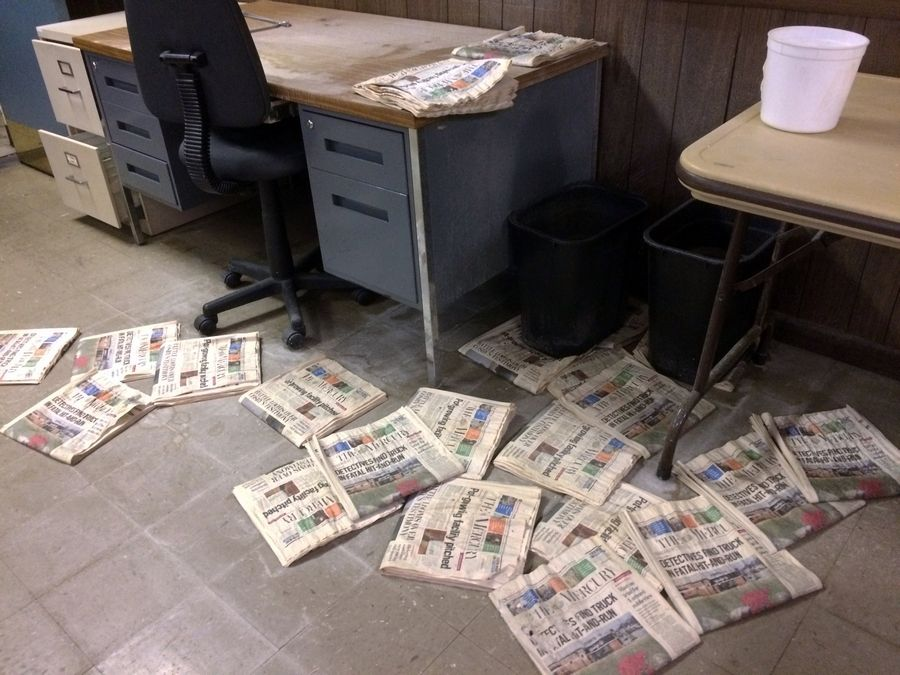 Old editions of the Pottsville Mercury litter the floor of the abandoned newspaper office in Pennsylvania.