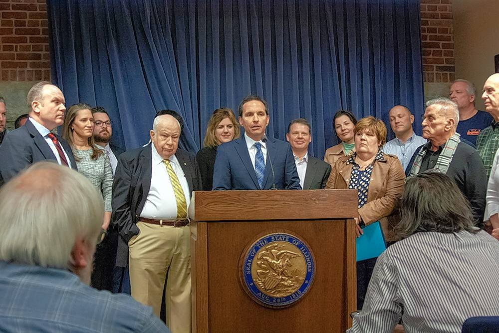 Rob Karr, president and CEO of the Illinois Retail Merchants Association, speaks during a news conference Monday in Springfield about his organization's opposition to a bill that would raise the state's minimum wage to $15 per hour by 2025.