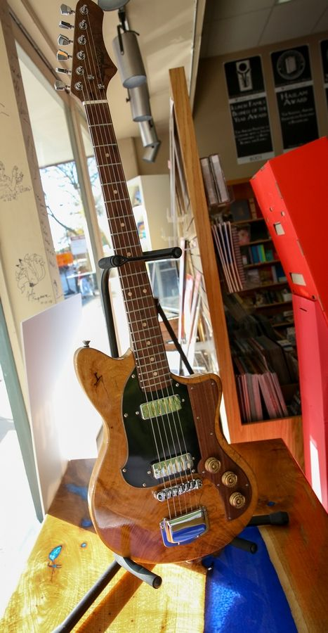A guitar made from the wood of the former Hobson Oak is among pieces that have helped the tree bring in more than $31,000 for charities in a project led by the Naperville Parks Foundation.