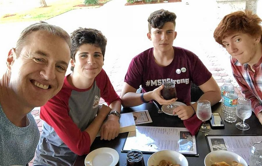"Author Dave Cullen, left, spent most of last year covering the movement that grew out of the Feb. 14, 2018, mass shooting at Marjory Stoneman Douglas High School in Parkland, Florida, for his book ""Parkland,"" released today. Here he meets with students, from left to right, Daniel Duff, Alfonso Calderon and Ryan Deitsch a month after the tragedy."