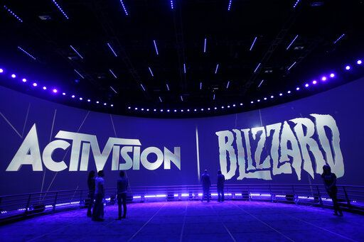 FILE - This June 13, 2013 file photo shows the Activision Blizzard Booth during the Electronic Entertainment Expo in Los Angeles. Video game maker Activision Blizzard is laying off nearly 800 workers as the company braces for a steep downturn in revenue following the best year in its history. The cutbacks announced Tuesday, Feb. 12, 2019, illustrate the boom-and-bust cycles in an industry whose fortunes are tied to video games that can have a relatively short lives before players move on to the next craze.