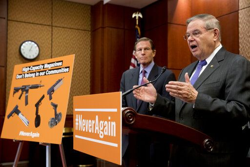Sen. Bob Menendez, D-N.J., right, accompanied by Sen. Richard Blumenthal, D-Conn., left, speaks at a news conference on an proposed amendment to ban high capacity magazines in guns, on Capitol Hill, Tuesday, Feb. 12, 2019, in Washington.