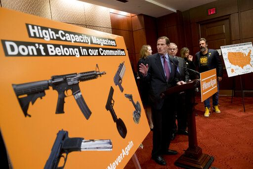 Sen. Richard Blumenthal, D-Conn., center, accompanied by Sen. Bob Menendez, D-N.J., third from right, speaks at a news conference on an proposed amendment to ban high capacity magazines in guns, on Capitol Hill, Tuesday, Feb. 12, 2019, in Washington.