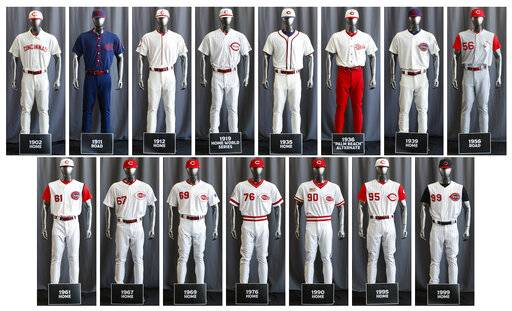 "In this compilation image, the entire Cincinnati Reds baseball team uniform lineup for the 2019 season is displayed, Friday, Jan. 25, 2019, in Cincinnati. The Reds will play games in 15 sets of throwback uniforms, including navy blue and a ""Palm Beach"" style, during a season-long celebration of the 1869 Red Stockings who pioneered professional baseball."