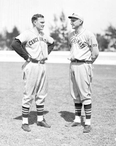 FILE - In this Feb. 25, 1935 file photo, John Mize, left, chats with coach George Kelly as he reports for spring training at the Cincinnati Reds' camp in Tampa, Fla.