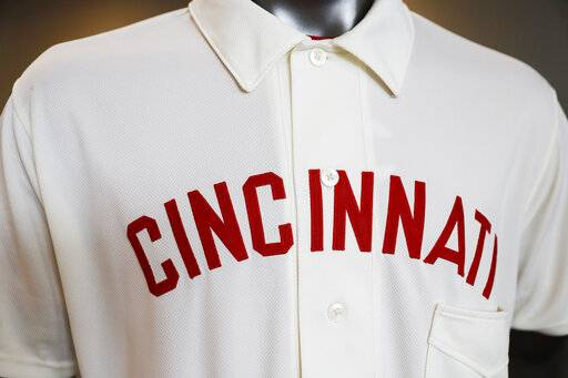 "The Cincinnati Reds baseball team uniforms for the 2019 season are displayed at Great American Ball Park, Monday, Jan. 7, 2019, in Cincinnati. The Reds will play games in 15 sets of throwback uniforms, including navy blue and a ""Palm Beach"" style, during a season-long celebration of the 1869 Red Stockings who pioneered professional baseball."