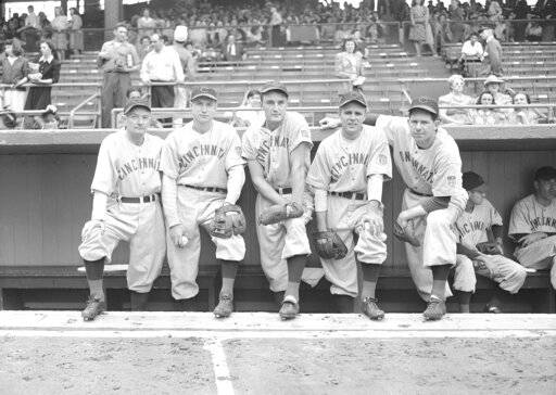 FILE - In this June 26, 1942 file photo, Cincinnati Reds All-Stars line up at Ebbets Field in Brooklyn, New York before a game with the Brook Dodgers. From left to right are Bill McKechnie; Bucky Walters, pitchers; Frank McCormick, first baseman; Johnny Vander Meer, pitcher, and Paul Derringer, pitcher.
