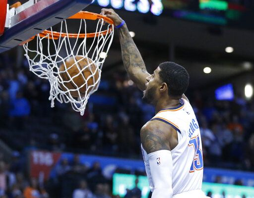 Oklahoma City Thunder forward Paul George (13) dunks in the first half of an NBA basketball game against the Portland Trail Blazers in Oklahoma City, Monday, Feb. 11, 2019.