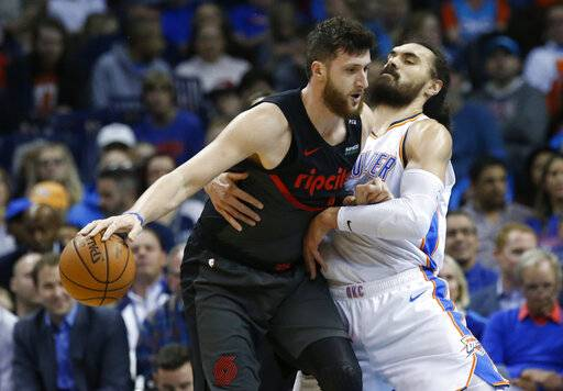 Portland Trail Blazers center Jusuf Nurkic, left, drives around Oklahoma City Thunder center Steven Adams, right, in the first half of an NBA basketball game in Oklahoma City, Monday, Feb. 11, 2019.