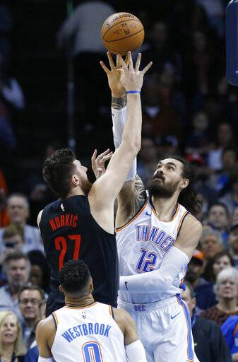 Portland Trail Blazers center Jusuf Nurkic (27) shoots as Oklahoma City Thunder center Steven Adams (12) defends in the first half of an NBA basketball game in Oklahoma City, Monday, Feb. 11, 2019.