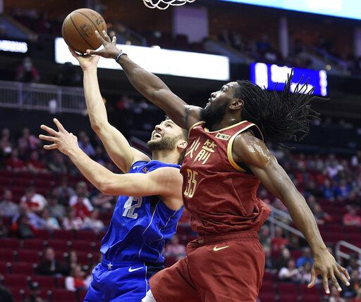 Dallas Mavericks forward Maximilian Kleber, left, shorts as Houston Rockets forward Kenneth Faried defends during the first half of an NBA basketball game, Monday, Feb. 11, 2019, in Houston.