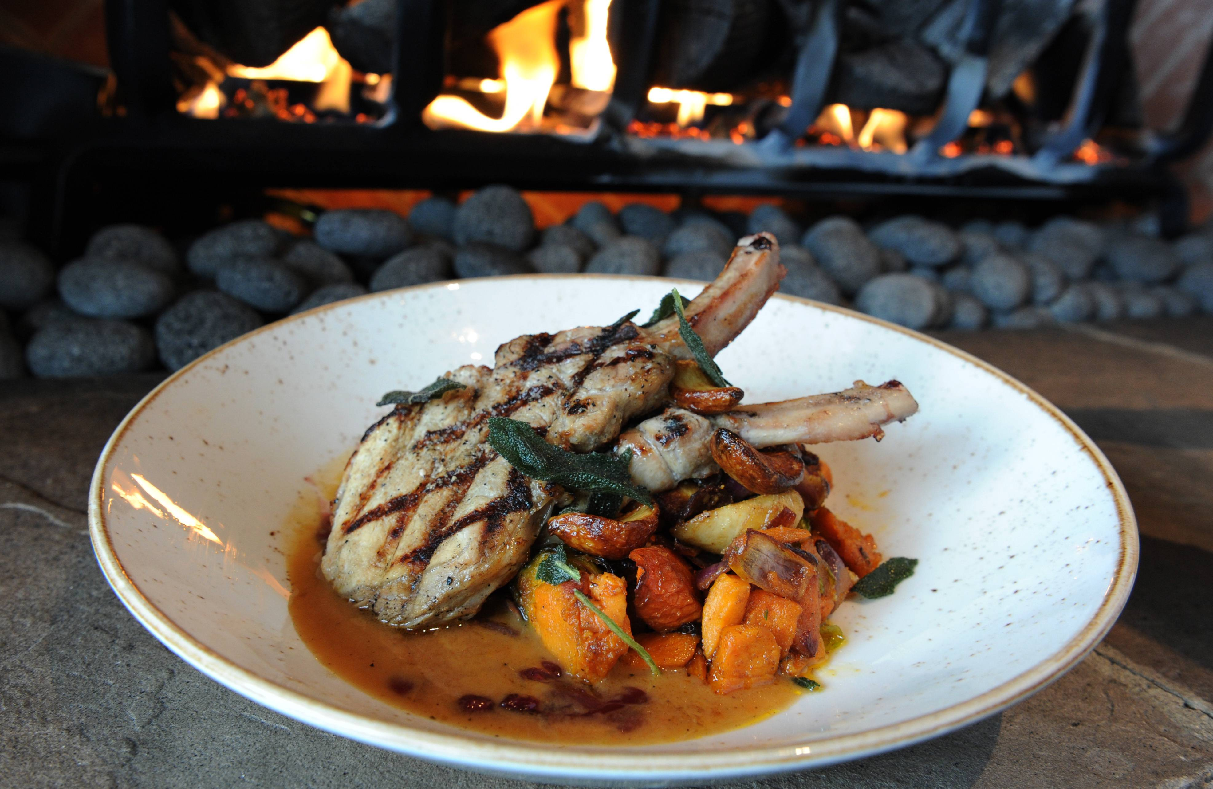 Lazy Dog's bone-in apple-sage pork chops is just one of many hearty dishes available at the new Vernon Hills restaurant.
