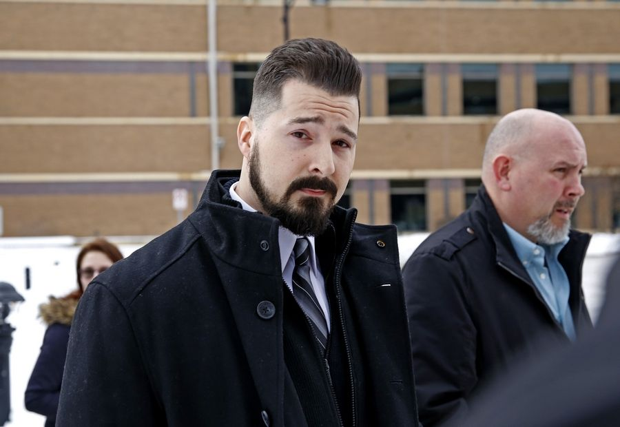 Former Schaumburg police officer John Cichy leaves the DuPage County Courthouse on Feb. 13, 2018, after charges that he stole and sold drugs were dropped. On Wednesday, a DuPage County judge refused to erase the charges from his record.