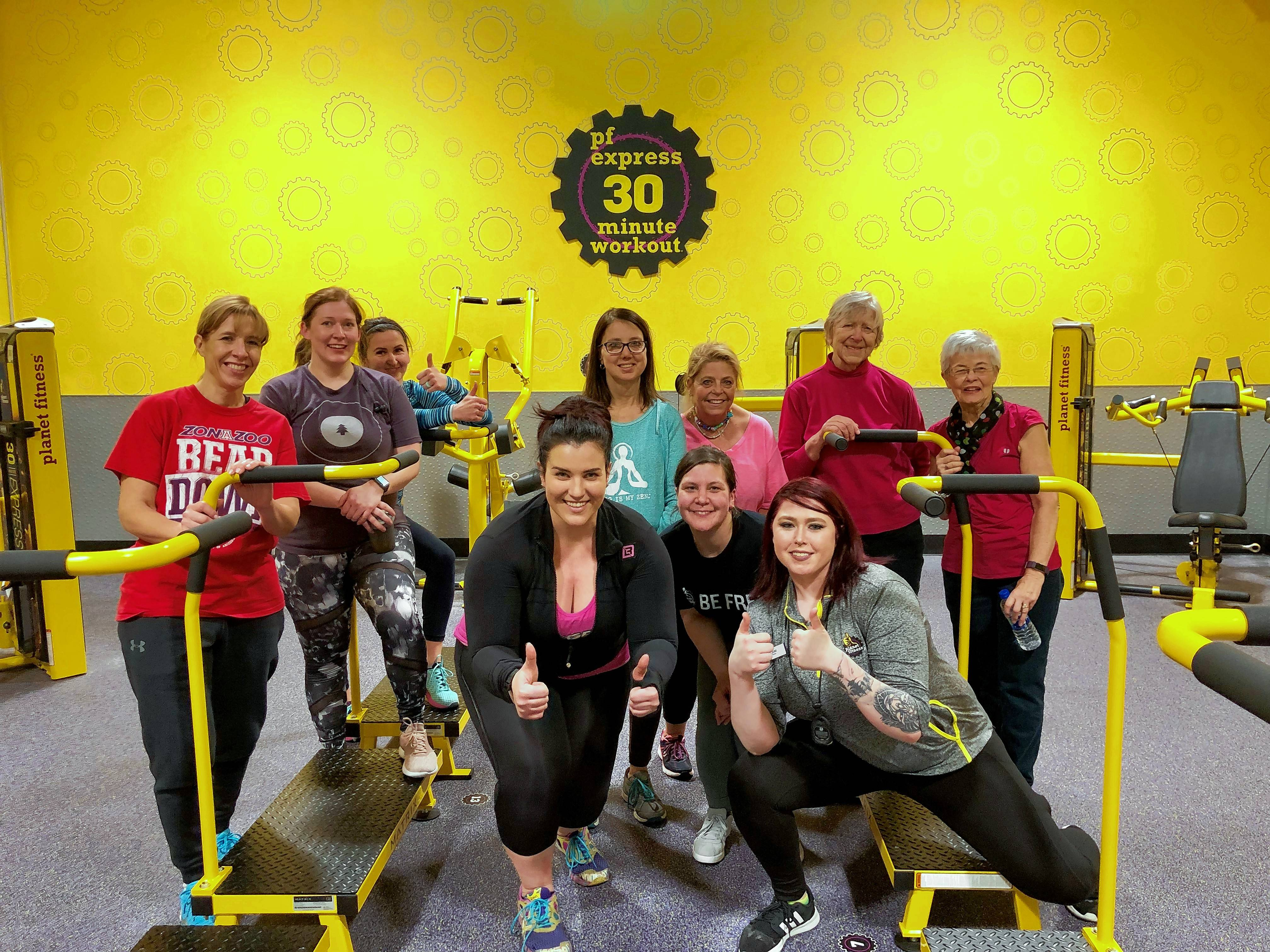 """Biggest Loser"" winner Danni Allen, center in black, led a workout session Tuesday, Feb. 12, after the grand opening of Planet Fitness in Elk Grove Village."