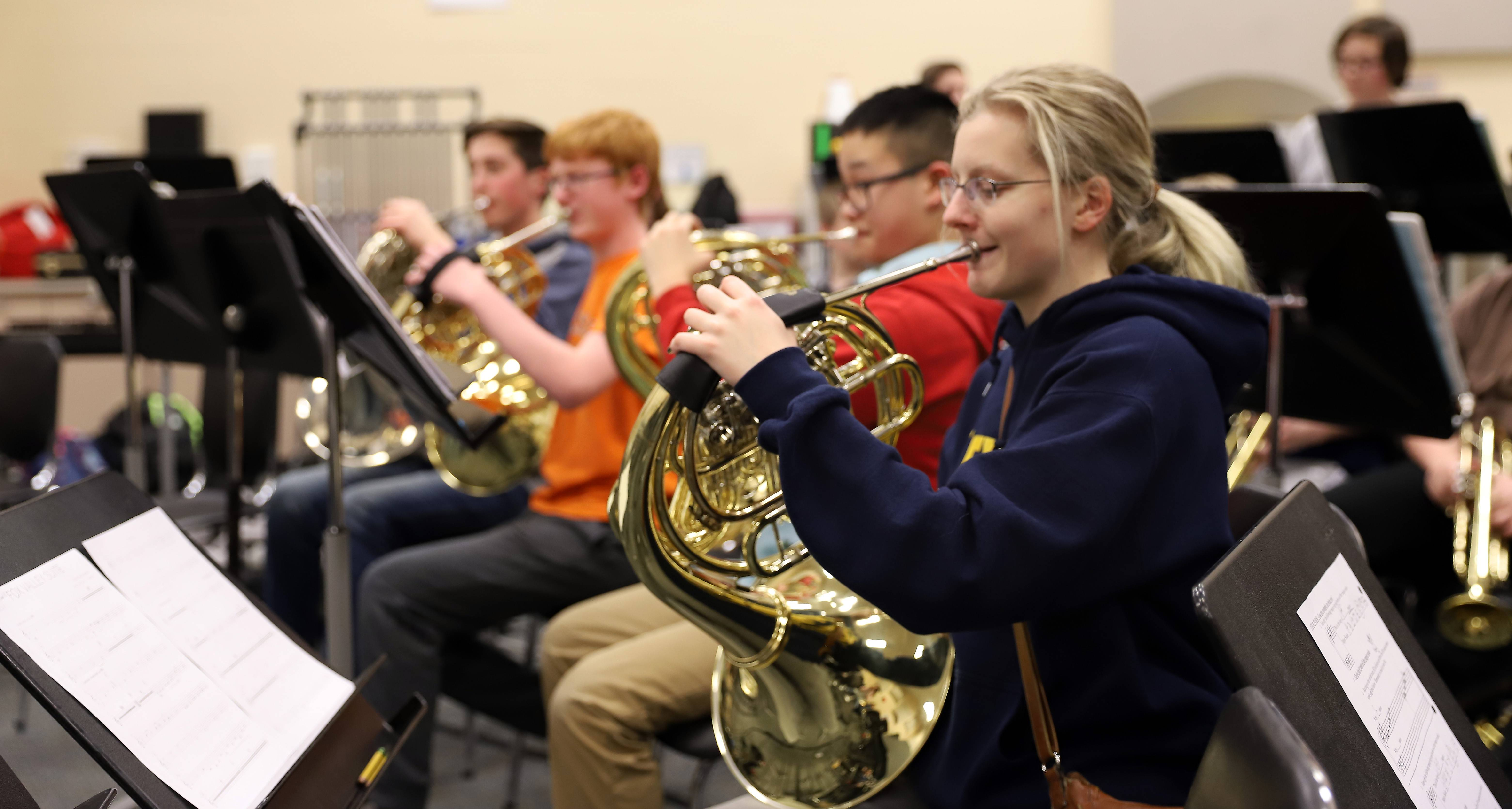 "The ""Fox Valley Suite"" musical composition has been years in the making and band members from Geneva middle schools and high school have been working to bring it all together for a concert Feb. 19 at Geneva Middle School South. From right (forefront to rear) are Veronica Ayars of Geneva High School, and middle schoolers Tyler Kroll, Brendan Coller and Calvin Hruby."
