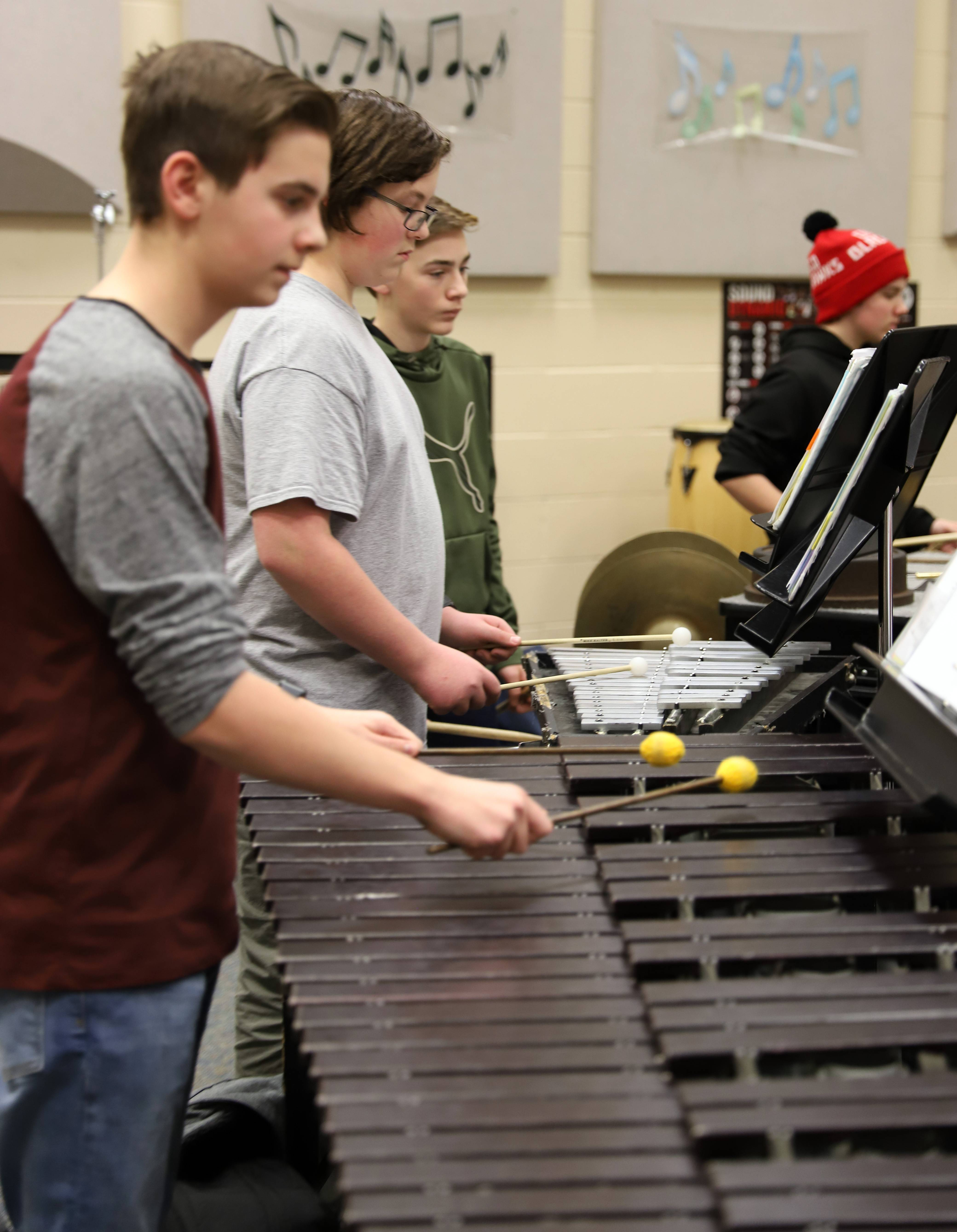 "The ""Fox Valley Suite"" musical composition will be performed at a concert Tuesday night at Geneva Middle School South. From left are middle schoolers Isaac Martin, Nathan Kilmer, David Roeder and Kai Marzolf."