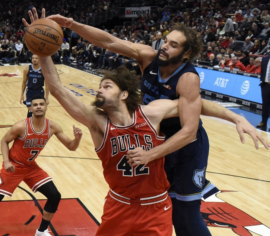 Chicago Bulls center Robin Lopez (42) and Memphis Grizzlies center Joakim Noah (55) go for the ball during the second half of an NBA basketball game, Wednesday, Feb. 13, 2019, in Chicago. The Bulls won 122-110.